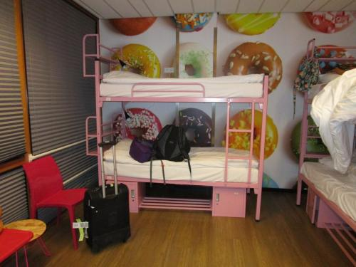 My bunk. With my own donut pillow. Lots of pink. I still love the room. Lots of room, shelves by the bed. Really comfortable.