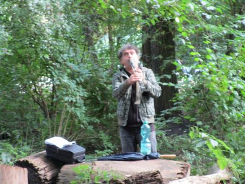 Dude playing clarinet in the trees in Vondelpark.